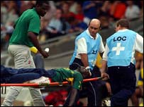 Foe being taken off the pitch by medical personnel