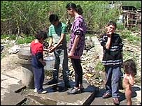 Roma children fetch water from the well
