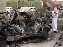 Saudi police survey the wreckage of one of the vehicles used in the bomb attacks
