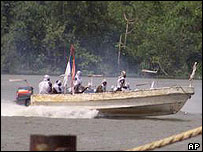 Ijaw militants in a speedboat
