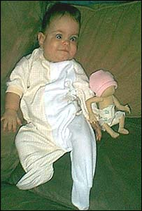 Jessyka this month with a doll made to her exact size at birth