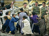 Iraqi boys with British soldiers at Qaryat Nasr