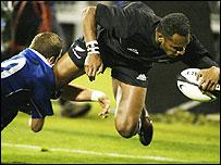 All Blacks wing Joe Rokocoko scores his third try against France