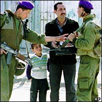 Israel soldiers man a Gaza checkpoint in the 1990s