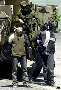 An Israeli soldier with Palestinian prisoners