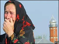 Woman relative mourns Chechen attack victims on Wednesday