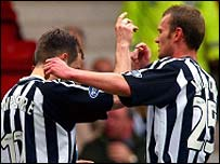 Stevie Hampshire and Scott Walker celebrate with Dunfermline