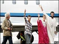 Former German hostages wave as they leave plane in Cologne