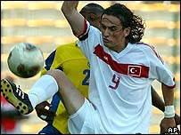 Turkey striker Tuncay Sanli fights for the ball with Gonzalo Martinez of Colombia