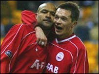 Laurent D'Jaffo (left) celebrates at Aberdeen