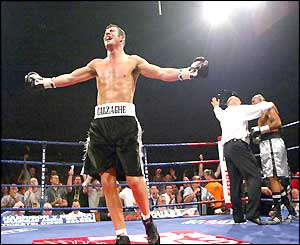 Joe Calzaghe turns away and celebrates as the fight is stopped