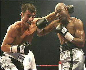 Byron Mitchell lands a right hook to knock Joe Calzaghe down