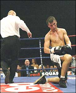 Joe Calzaghe gets up off his knees after being knocked down by Byron Mitchell