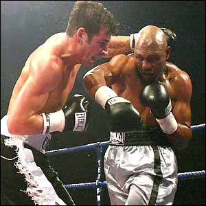 Joe Calzaghe and Byron Mitchell exchange early blows
