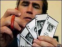 A Texas Republican cuts out photocopies of playing cards featuring House Democrats