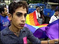 Indian men wearing lipstick and jewellery carry rainbow flag at Calcutta march