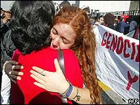Argentine relatives of victims embrace as Cavallo is transported to Mexico City's international airport