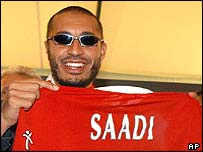 Saadi Gaddafi and his new club's shirt