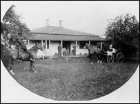 In front of the building is James McCowan's grandson Robert, his wife and family. The picture is taken c 1900