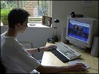 A young man surfing the internet at home