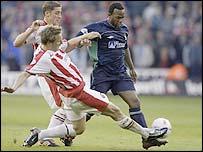 Phil Jagielka (left) twice crucially blocked Nottingham Forest striker David Johnson's shots