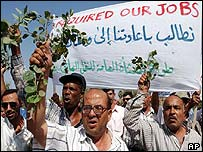 Iraqi oil workers, who lost their jobs following the fall of Saddam Hussein, demand employment from the new US administration