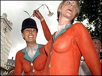 Pro-hunt supporters in body paint fox hunting outfits