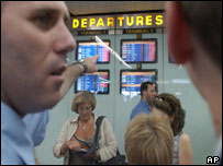 People looking at delayed flights at Ben-Gurion Airport