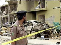 A Saudi police officer guards a bomb scene in Riyadh, 15 May 2003