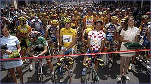 Chris Boardman (centre) in the leader's yellow jersey at the Tour de France