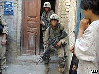 US troops conduct a house-to-house search in Iraq