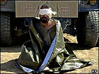 Blindfolded prisoner in Iraq