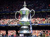 A giant inflatable FA Cup is positioned at the 2002 FA Cup final