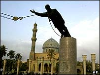 A statue of Saddam Hussein is toppled, Baghdad, 9 April 2003