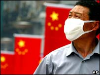 Chinese man wearing face mask, AP