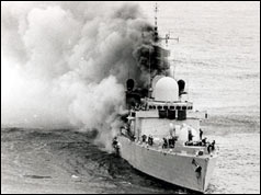 HMS Sheffield burns after being hit by an Argentine missile