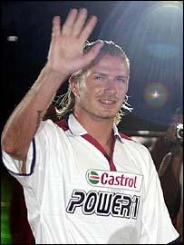 David Beckham waves to the crowds in Bangkok