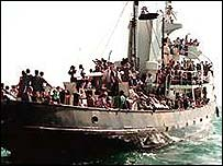 Boat packed with immigrants off Italian coast