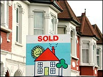 A house with a sold sign outside