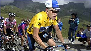 Lance Armstrong leads the pack through the mountains