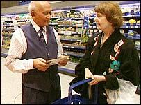 Older employee in a supermarket
