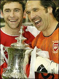 Martin Keown and David Seaman celebrate
