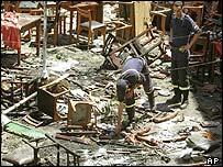 Policemen inspect wrecked terrace of Casa de Espana restaurant