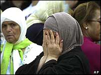 A woman mourns a bomb victim