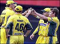 Ian Harvey of Australia, right, is congratulated by Glenn McGrath