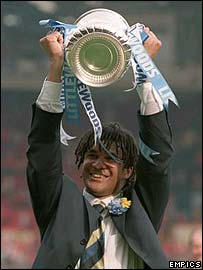 Then Chelsea manager Ruud Gullit lifts the FA Cup in 1997