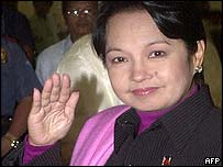 Philippines President Gloria Arroyo leaves for the United States