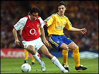 Robert Pires (left) and Chris Baird