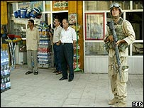 Iraqis watch as US soldiers go on high alert after gunshots are heard in Baghdad