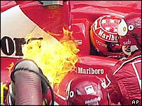 Fire breaks out on Michael Schumacher's car during a pit stop at the Austrian Grand Prix